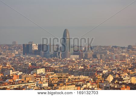 Barcelona Spain - January 03 2017: Agbar tower in the background of the urban landscape of Barcelona