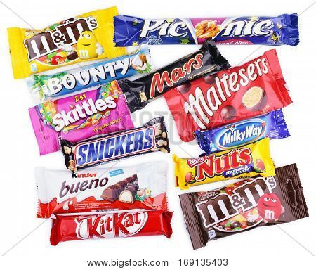 MOSCOW - DECEMBER 10 2014: Closeup of various chocolate bars isolated on white with clipping path - Snickers, Skittles, Mars, Kinder Bueno, Kit Kat, Bounty, Picnic, Maltesers, Milky Way, Nuts, M&M's