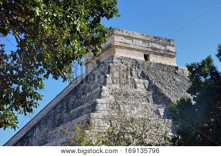 Temple at Chichen Itza Mexico with tree in foreground
