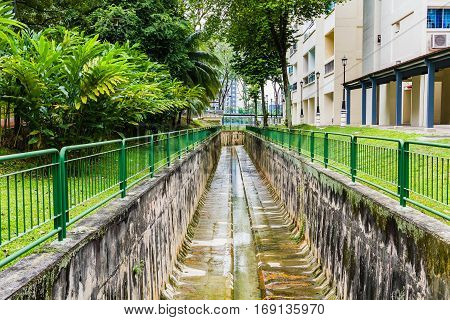 Concrete drainage canal Irrigation ditch in the city Dirty drainage canal with concrete retaining wall
