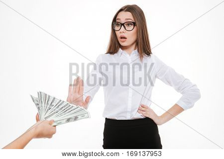 Serious businesswoman refusing to take bribe isolated on white. Corruption concept