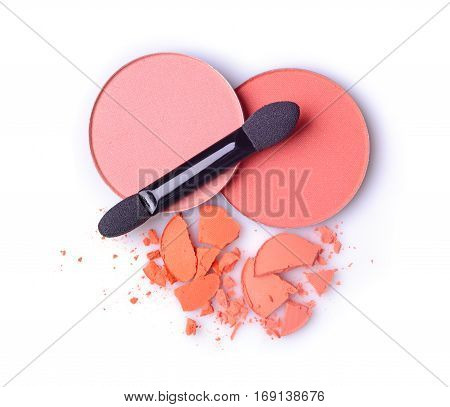 Round Orange Crashed Eyeshadow And Blusher For Makeup As Sample Of Cosmetics Product With Applicator