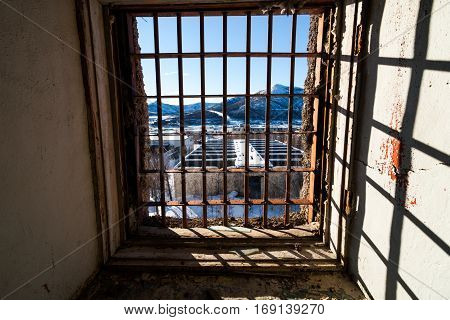 View through latticed window of abandoned prison in Kolyma
