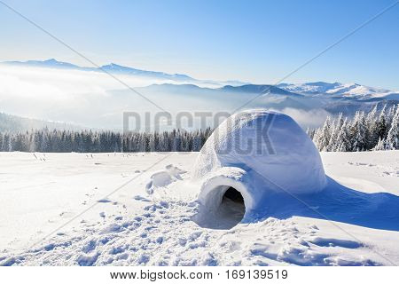 Marvelous huge white snowy hut igloo the house of isolated tourist is standing on high mountain far away from the human eye