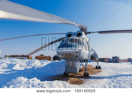 A large helicopter on the ground in winter Russia