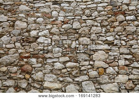 Old Stone Layered Wall Of Fortress Or Castle