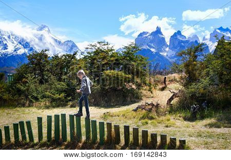 little boy having fun in torres del paine national park patagonia chile active travel concept