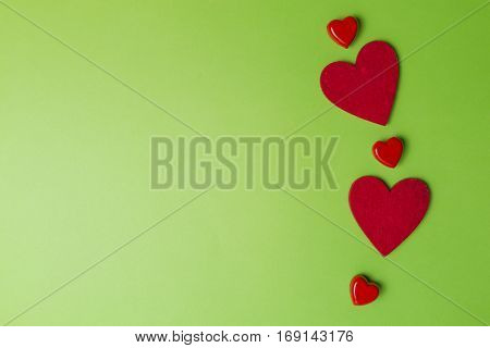 Red hearts greenery valentines day background. Minimal style. Flat lay. Top view. Copy space for text
