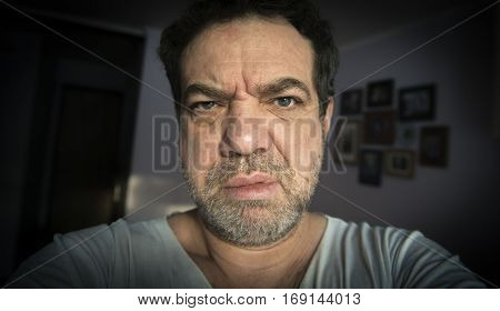 Middle-aged angry man. Selfies.