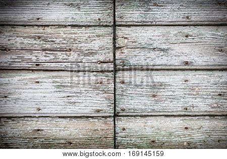 Old vintage wooden door background with cracked paint and rusty nails