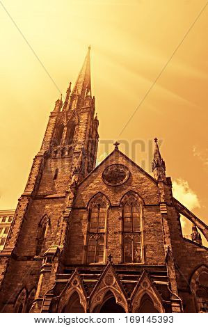 Old church of Boston Downtown vintage look colorized with flare and copyspace.