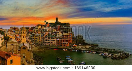 Sunset view from hill of Vernazza houses and blue sea, Cinque Terre national park, Liguria, Italy