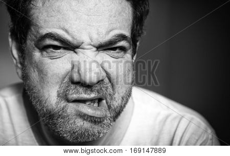 Squeamish middle-aged man. Black and white monochrome portrait.