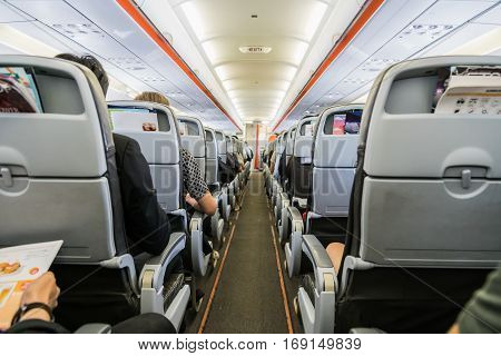 Airplane With Passengers On Seats Waiting To Take Off