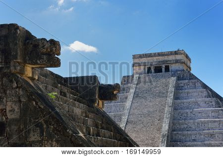 Chichen Itza wall and temple in background