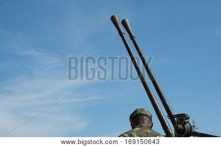 Soft focused picture of Looking to back of Soldier with Artillery Force machines or Army equipment big gun with nice blue sky