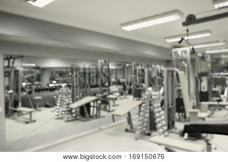 Gym interior with equipment, blurred