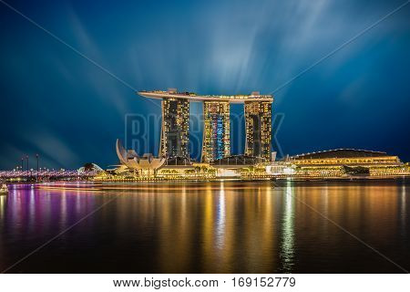 SINGAPORE - DECEMBER 10 2016: The Helix Bridge Marina bay sands & Artscience museum at night. Marina Bay Sand iconic design has transformed Singapore's skyline. Designed by architect Moshe Safdie.