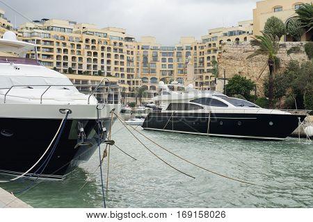 Super yachts moored at Portomaso Marina in St. Julian Malta
