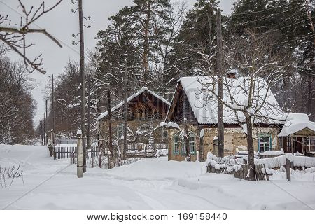 The old village in the Russian hinterland, winter, snow-covered road