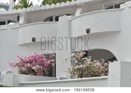 Moorish style architecture and cobblestone streets with plazas and fountains is a hallmark of Las Hadas Resort in Manzanillo, Colima, Mexico.