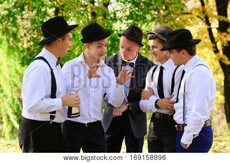 True really friends speak about something and demonstrate. Group of men talking outdoors in good weather. Men's Group communication. Cheerful old friends having fun. Group of olf men friends speaking talking about something