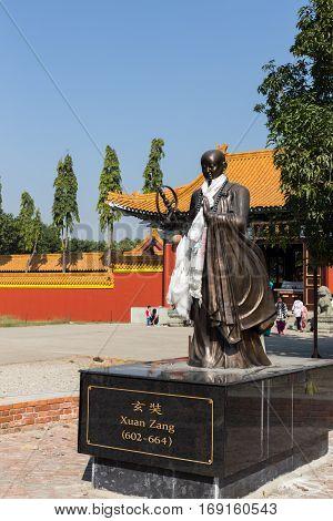 Lumbini, NEPAL - November 17, 2016: Xuan Zang. Chinese monk statue near the Chinese temple, Lumbini, Nepal.