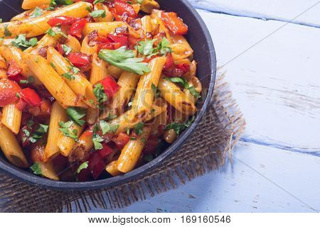 Penne pasta in pan with space for text