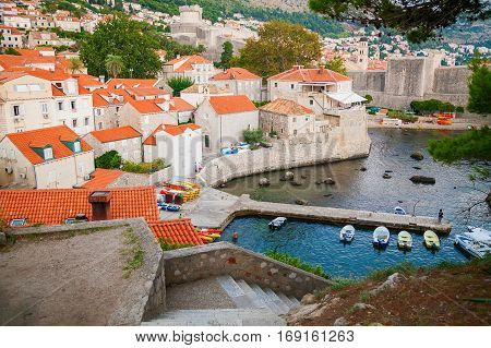 small houses with red roofs in the Dubrovnik harbor Croatia