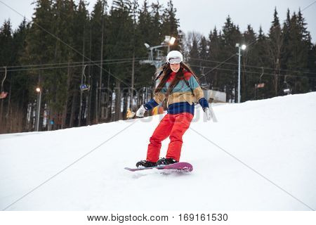 Image of young lady snowboarder on the slopes frosty winter day. Look aside.