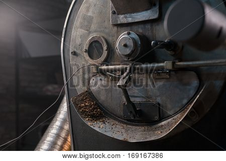Coffee beans cooking during the roasting process, drum type roaster
