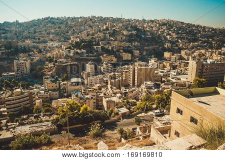 Photo of the Amman city, Jordan capital. Aerial view from Citadel hill. Urban landscape. Residential area. Arabic architecture. Eastern city. Travel concept