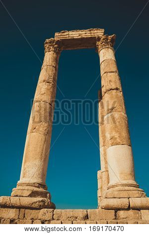 Photo of the Impressive columns with architrave. Remains Hercules Temple. Ancient architecture. Tourist attraction. Sightseeing tour. Famous historical monument. Travel concept. Archaeological site