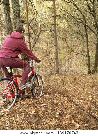 The guy on the red bicycle in the woods