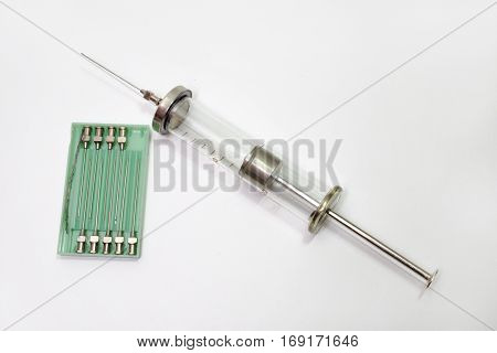 glass medical syringe with green box for needles. Special equipment