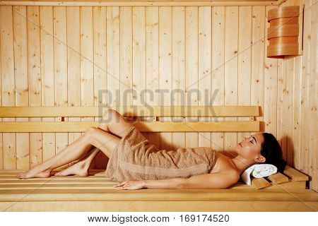 Attractive young women enjoying in sauna in spa
