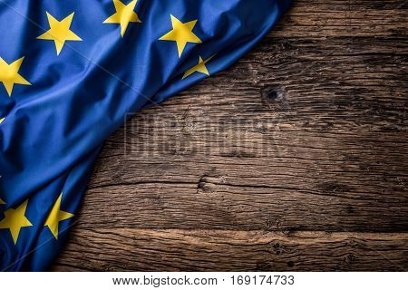 Flag of Europe union on old wooden background. EU flag old oak background.