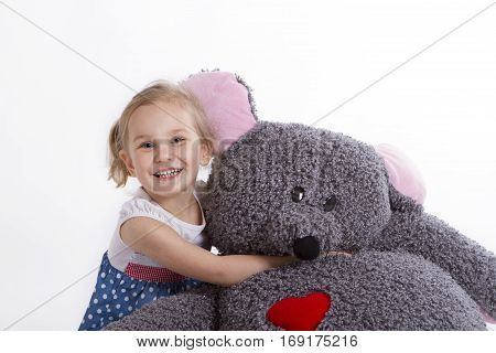 little baby girl with big soft toy mouse with heart