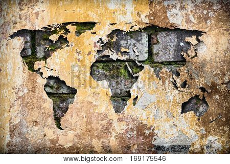 World map atlas on an old cracked paint dirty vintage abstract ruin wall background