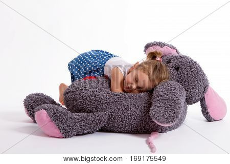 little baby girl with big soft toy mouse with heart sleeping