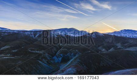 Red bumpy mountain at sunset in winter evening.Khizi.Azerbaijan