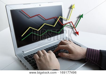 human hands over laptop keyboard and graphics