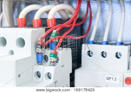 On the mounting panel in the electrical Cabinet there are installed circuit breakers protect the motor. Circuit breakers protect motors connected by wires with the terminals and marking.