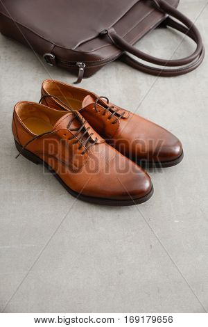 Men's casual outfits with Luxury leather  shoes and handbag on gray background