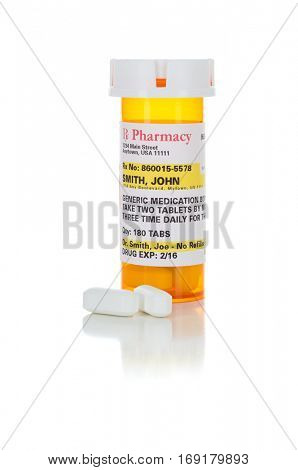 Non-Proprietary Medicine Prescription Bottle and Pills Isolated on a White Background. These labels contains only fictitious information.