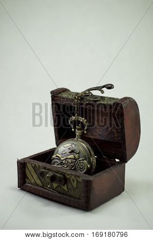 Clock perfectly complement a small chest on the light background.