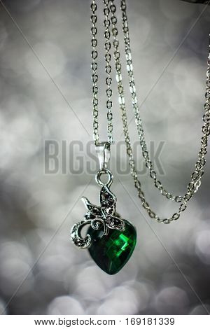 Abstract photo jewelry pendant with green crystal.