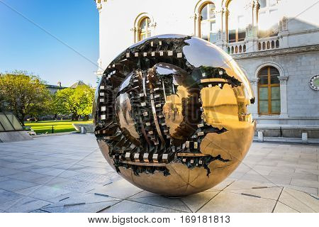 DUBLIN IRELAND - June 2 2016: Sphere Within Sphere is a bronze sculpture in Trinity College Dublin