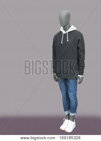 Full-length male mannequin dressed in black sweater and blue jeans. Isolated on white background. No brand names or copyright objects.