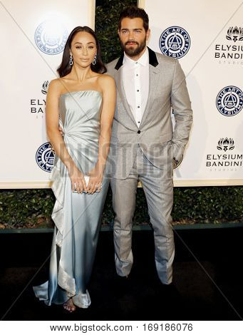 Jesse Metcalfe and Cara Santana at the Art of Elysium Celebrating the 10th Anniversary held at the Red Studios in Los Angeles, USA on January 7, 2017.